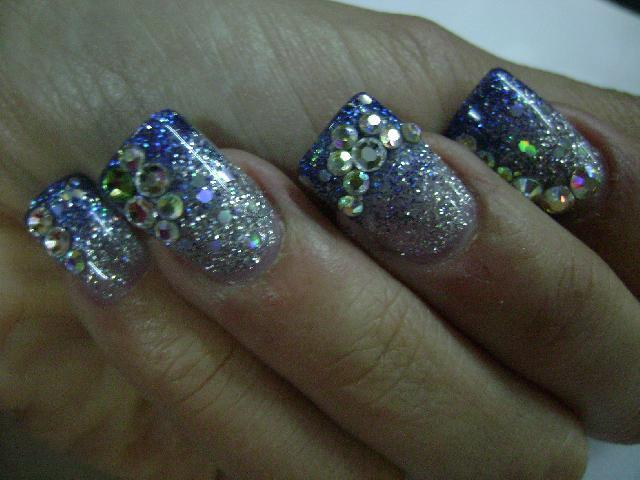 U as con cristales swarovski imagui for Cristales swarovski para decorar unas